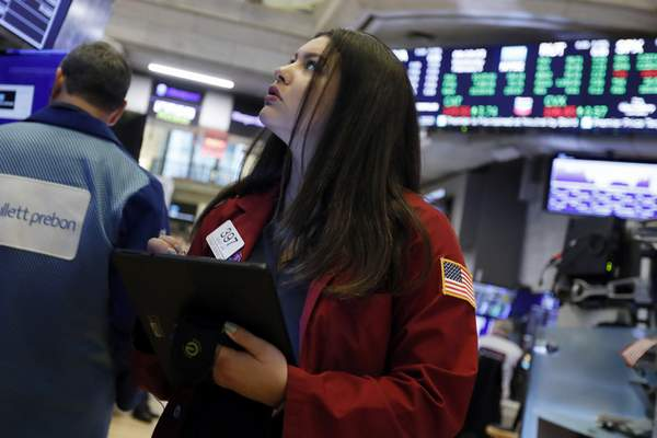 FILE - In this Feb. 5, 2020, file photo trader Ashley Lara works on the floor of the New York Stock Exchange. The U.S. stock market opens at 9:30 a.m. EST on Wednesday, Feb. 19. (AP Photo/Richard Drew, File)