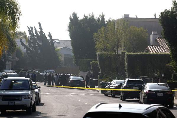 Police investigate a Hollywood Hills home where a fatal shooting occurred on Wednesday, Feb. 19, 2020, in Los Angeles. (AP Photo/Ringo H.W. Chiu)