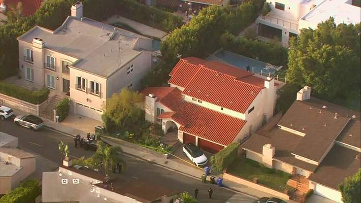 This aerial photo taken from video provided by Fox11 News KTTV-TV shows the Hollywood Hills home, center, where Pop Smoke, 20, was shot and killed early Wednesday, Feb. 19, 2020, in Los Angeles. Republic Records says in a statement that the label is devastated by the unexpected and tragic loss of the rapper. The shooting occurred before dawn Wednesday. Public listings show that the home which is a rental is owned by Edwin Arroyave and his wife Teddi Mellencamp, daughter of singer John Mellencamp and star of