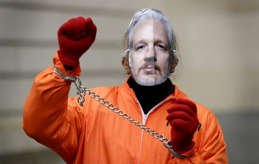 Britain Julian Assange A demonstrator supporting Julian Assange wears a mask and chains outside Westminster Magistrates Court in London, Thursday, Jan. 23, 2020. Assange is scheduled to be presented before the court by videolink, for a case management hearing ahead of his full extradition trial which begins on Feb. 24. (AP Photo/Kirsty Wigglesworth) (Kirsty Wigglesworth STF)
