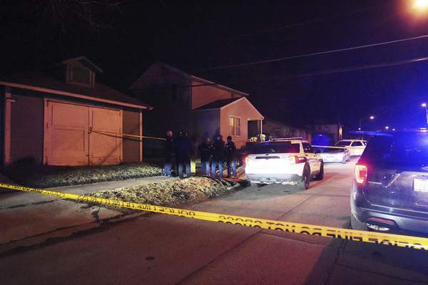 Katie Fyfe | The Journal Gazette Fort Wayne police work the scene of a shooting Wednesday night off McKee Street that sent a minor to the hospital.