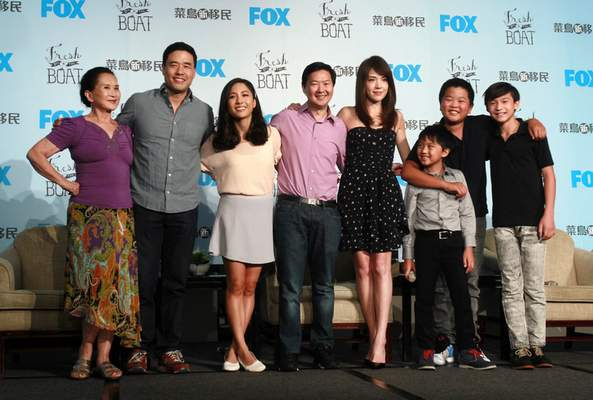 FILE - In this Friday, Aug. 5, 2016 file photo, actors, from left, Lucille Soong, Randall Park, Constance Wu, Ken Jeong, Ann Hsu, Ian Chen, Hudson Yang and Forrest Wheeler pose for photographers during a media event promoting their television comedy series