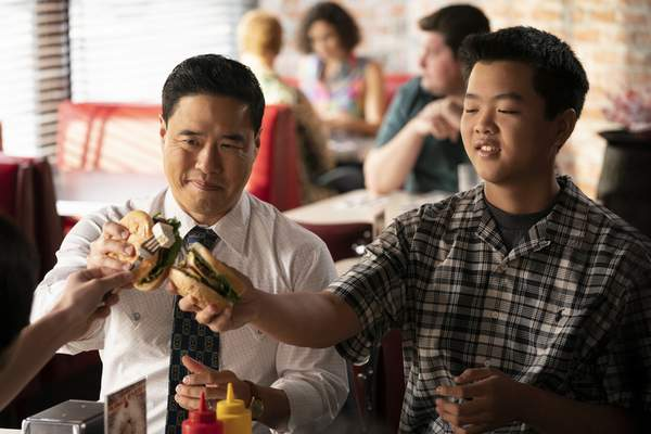This undated photo made available by ABC shows Randall Park, left, and Hudson Yang in the Jan. 31, 2020 television episode of