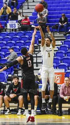 Mike Moore | The Journal Gazette Purdue University Fort Wayne guard Jarred Godfrey takes a shot at the basket in the first half against Omaha at Hilliard Gates Sports Center on Thursday.
