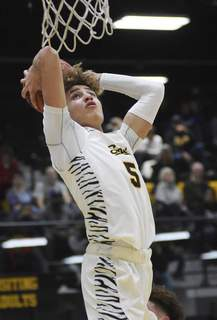 Katie Fyfe | The Journal Gazette Snider junior Michael Eley goes up for a shot in the first quarter against South Side on Friday night at Snider.
