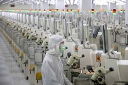 China US Trade Associated Press A worker sits at a production line at a microelectronics factory in Nantong in eastern China's Jiangsu Province. China has suspended more punitive tariffs on imports of U.S. industrial goods. (STR)