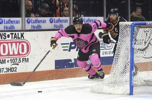 Katie Fyfe | The Journal Gazette  Komets forward Brady Shaw chases the puck during the first period againsttheIndy Fuel at Memorial Coliseum on Saturday.