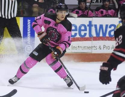 Katie Fyfe | The Journal Gazette  Komets forward Brad Morrison looks to make a pass during the second period against the Indy Fuel at Memorial Coliseum on Saturday.