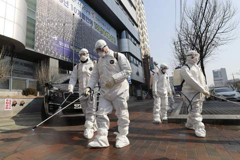 Virus Outbreak Clusters Associated Press Workers wearing protective gear spray disinfectant against the new coronavirus Thursday in front of a church in Daegu, South Korea. (Kim Jun-beomSUB)