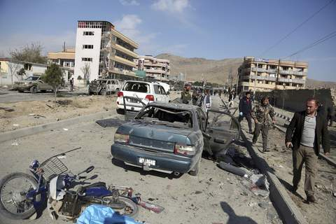 Afghanistan Sigar Associated Press Afghan security personnel gather at the site of a car bomb attack in Kabul in November – the kind of attack that could cause a truce to fall apart. (Rahmat GulSTF)