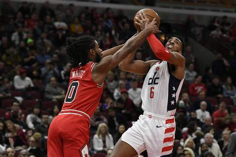 Wizards Bulls Basketball Washington Wizards' Troy Brown Jr. (6) goes up to shoot against Chicago Bulls' Coby White (0) during the first half of an NBA basketball game Sunday, Feb. 23, 2020, in Chicago. (AP Photo/Paul Beaty) (Paul Beaty
