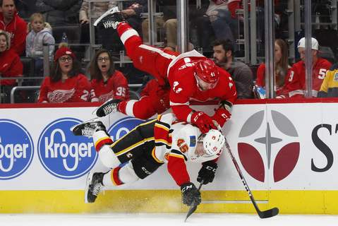 APTOPIX Flames Red Wings Hockey Detroit Red Wings center Luke Glendening (41) and Calgary Flames defenseman Alexander Yelesin (45) collide along the boards in the first period of an NHL hockey game Sunday, Feb. 23, 2020, in Detroit. (AP Photo/Paul Sancya) (Paul Sancya