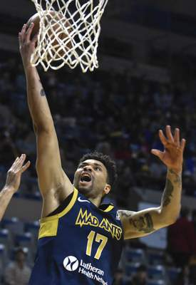 Michelle Davies | The Journal Gazette  The Mad Ants' Stephan Hicks goes to the basket in the second quarter of Sunday's game against Canton at Memorial Coliseum.