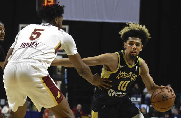 Michelle Davies | The Journal Gazette  The Mad Ants' Brian Bowen II works his way around the defense of Canton's Marques Bolden in the first quarter of Sunday's game at the Memorial Coliseum.