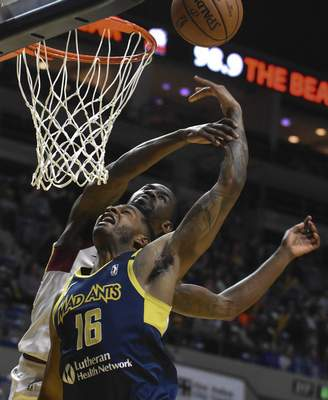 Michelle Davies | The Journal Gazette  The Mad Ants' C.J. Wilcox goes up to the basket with Canton's Sir'Dominic Pointer looking to block the shot in the second quarter of Sunday's game at Memorial Coliseum.