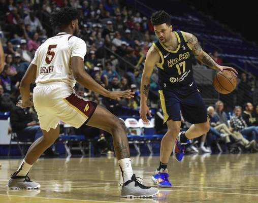 Michelle Davies | The Journal Gazette  The Mad Ants' Stephan Hicks works to get the ball around Canton's Marques Bolden in the first quarter of Sunday's game at Memorial Coliseum.