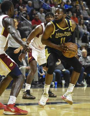 Michelle Davies | The Journal Gazette  The Mad Ants' Scoochie Smith looks for a way around Canton's defense in the first quarter of Sunday's game at Memorial Coliseum.