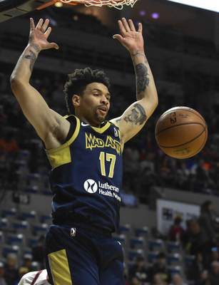 Michelle Davies   The Journal Gazette  Mad Ants' Stephan Hicks dunks in the first quarter of Sunday's game against Canton at the Memorial Coliseum.