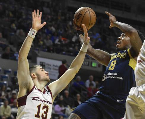 Michelle Davies   The Journal Gazette  The Mad Ants' Daxter Miles Jr., goes to the basket whileCanton's Matt Mooney tries to block the shot in the second quarter of Sunday's game at Memorial Coliseum.