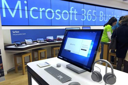 Virus Outbreak Microsoft FILE - In this Jan. 28, 2020, file photo a Microsoft computer is among items displayed at a Microsoft store in suburban Boston. (AP Photo/Steven Senne, File) (Steven Senne