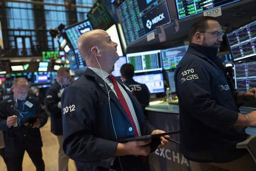 Financial Markets Wall Street Stock traders work at the New York Stock Exchange, Wednesday, Feb. 26, 2020. (AP Photo/Mark Lennihan) (Mark Lennihan