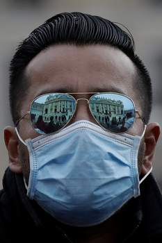APTOPIX Vatican Pope A man wears a face mask in St. Peter's Square at the Vatican during Pope Francis' weekly general audience, Wednesday, Feb. 26, 2020. (AP Photo/Alessandra Tarantino) (Alessandra Tarantino STF)