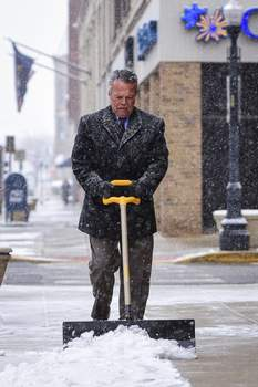 Mike Moore   The Journal Gazette Attorney Mark Thoma shovels snow Wednesday outside his office along West Berry Street. Nearly 3.5 inches of snow had fallen as of 7 p.m. Wednesday as winds picked up and temperatures dropped. (The_Journal_Gazette)