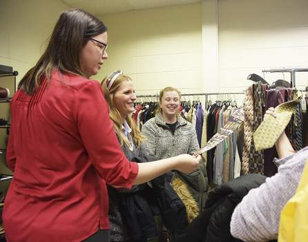 Photos by Katie Fyfe   The Journal Gazette Checking out the free clothing available Wednesday at the grand opening of Purdue Fort Wayne's Mastodon Career Closet are, from left, Sara Thomas, Ashley Blauvelt and Lindsay Butcher.