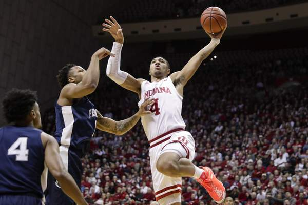Indiana forward Trayce Jackson-Davis (4) and the Hoosiers are just a few wins from securing an NCAA Tournament berth. They take on Purdue at Mackey Arena tonight. (AP Photo/Michael Conroy)
