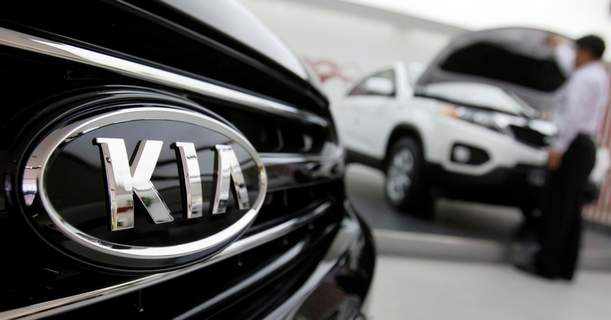 Kia Engine Fires FILE - In this Oct. 23, 2009 file photo, a Kia Motors Corp. employee looks into a Kia vehicle at its showroom in Seoul. Kia is recalling more than 193,000 cars and minvans in yet another move to fix nagging problems that could cause engine fires. The largest of two U.S. recalls released by the government Thursday, Feb. 27, 2020, covers certain 2013 and 2014 Optima midsize cars. (AP Photo/ Lee Jin-man, File) (Lee Jin-man STF)