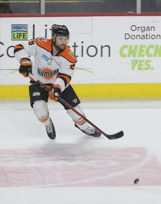Justin A. Cohn | The Journal Gazette  Komets forward Matthew Boudens passes the puck Friday night at the Huntington Center in Toledo, Ohio.