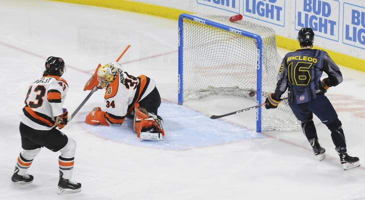 Justin A. Cohn | The Journal Gazette  Komets goaltender Patrick Munson, middle, and teammate Gabriel Verpaelst, left, react after Toledo's Kyle Bonis scores Friday at the Huntington Center on an assist from Gregor MacLeod, right, in Toledo, Ohio.