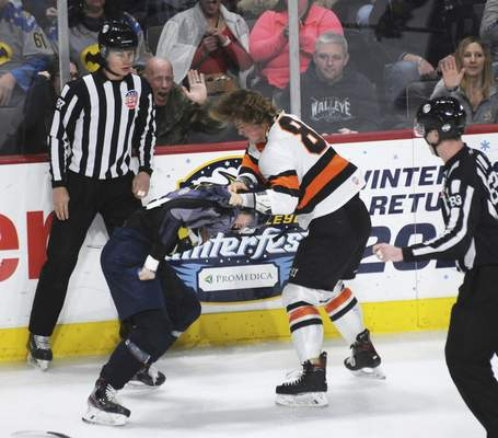 Justin A. Cohn | The Journal Gazette Fort Wayne's Drake Rymsha, right, fights Toledo's Troy Loggins during the first period Saturday in Toledo.