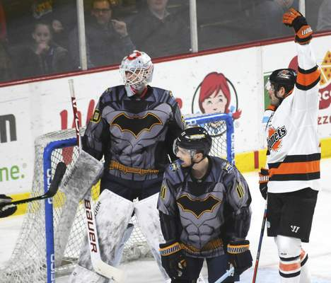 Justin A. Cohn | The Journal Gazette  The Komets' Brady Shaw, right, calls to the referee for a delay-of-game penalty, which is called, as Toledo's Nolan Gluchowski, middle, and Filip Larsson look on Saturday at Toledo, Ohio.