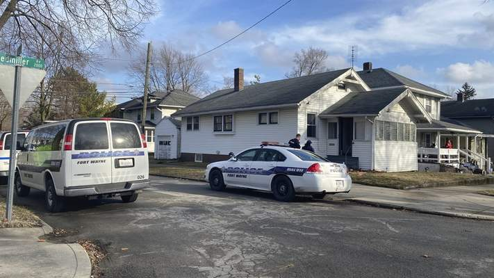Michelle Davies | The Journal Gazette  Fort Wayne police investigate two people found dead in the 2400 block of Riedmiller Avenue Monday afternoon.