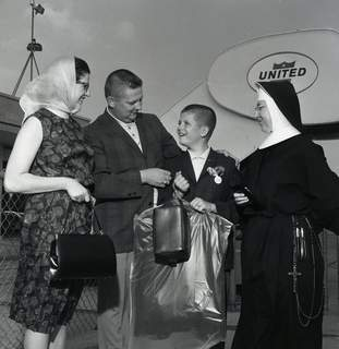 Ralph Banasiak gets ready to board a plane at Baer Field on June 5, 1966. With him are his parents and Sr. Jane Therese, principal of St. John's Catholic School in New Haven. (Journal Gazette file photo)