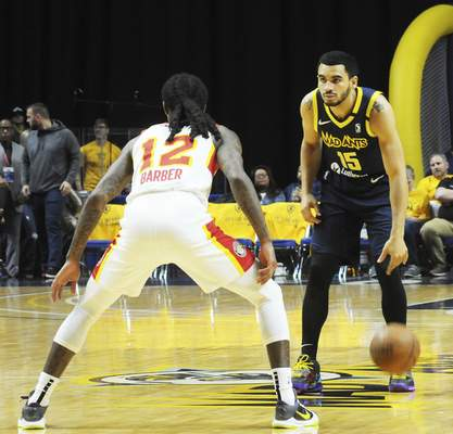Justin A. Cohn | The Journal Gazette  The Mad Ants' Naz Mitrou-Long, right, is defended by College Park's Cat Barber on Friday at Memorial Coliseum.