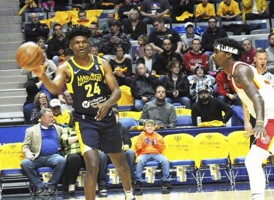 Justin A. Cohn | The Journal Gazette  The Mad Ants' Alize Johnson, left, passes the ball while College Park's Kenny Gabriel looks on Friday at Memorial Coliseum.