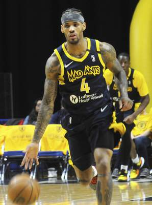 Justin A. Cohn | The Journal Gazette  The Mad Ants' Walt Lemon Jr. carries the ball up the Memorial Coliseum court on Friday.