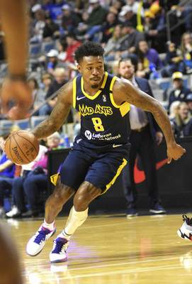 Katie Fyfe   The Journal Gazette  Mad Ants guard Daxter Miles Jr. drives to the basket during the second quarter against the Grand Rapids Drive at Memorial Coliseum on Sunday.