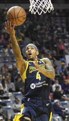 Katie Fyfe | The Journal Gazette Mad Ants guard Walt Lemon Jr. drives to the basket during the third quarter Sunday against Grand Rapids. Late in the fourth quarter, he hit the game-winning shot.
