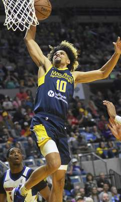 Katie Fyfe | The Journal Gazette  Mad Ants guard Brian Bowen IIgoes up for a shot during the third quarter against Grand Rapids Drive at Memorial Coliseum on Sunday.