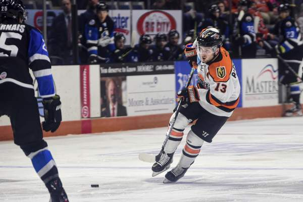 Mike Moore | The Journal Gazette Komets forward Anthony Petruzzelli passes the puck in the first period against Wichita at Memorial Coliseum on Wednesday.
