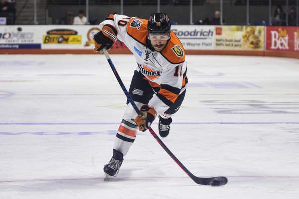 Mike Moore | The Journal Gazette Komets forward Brady Shaw takes a shot at the net in the first period against Wichita at Memorial Coliseum on Wednesday.