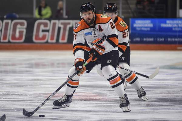 Mike Moore | The Journal Gazette Komets forward Shawn Szydlowski looks to pass the puck in the first period against Wichita at Memorial Coliseum on Wednesday.