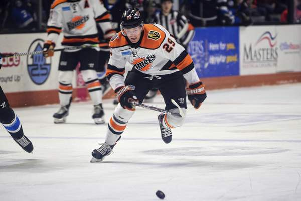 Mike Moore | The Journal Gazette Komets forward Mason Bergh chases down the puck the first period against Wichita at Memorial Coliseum on Wednesday.