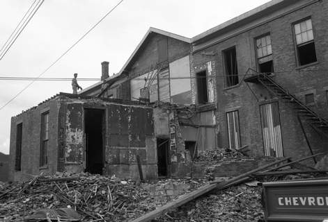 July 23, 1959: Workers continue efforts to raze a two-block stretch of buildings that formerly housed shops, freight and division offices of the Pennsylvania Railroad Co. along Brackenridge Street in Fort Wayne. (Journal Gazette file photo)