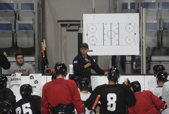 File Komets coach Ben Boudreau instructs players during a practice this season at Memorial Coliseum.
