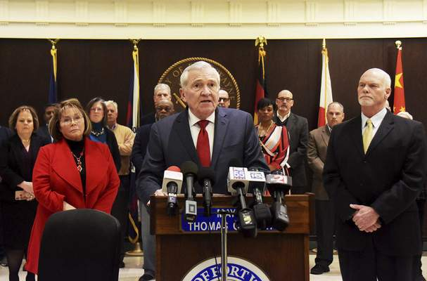 Katie Fyfe | The Journal Gazette Mayor Tom Henry, joined by local leaders and officials, talks about the community's preparation and readiness to respond to the coronavirus pandemic  at the mayor's office on Friday.