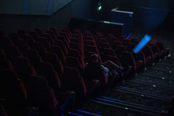 Associated Press A sole spectator watches a film Thursday at a movie theater in Budapest, Hungary, where cinemas are limited to 99 tickets per show amid the global coronavirus outbreak.